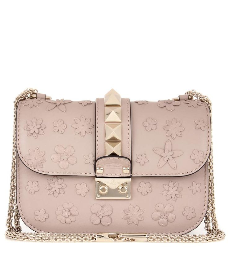 VALENTINO - Valentino Garavani Rockstud appliquéd leather crossbody bag - Downsize your tote to this practical shoulder bag from Valentino Garavani. Taupe-hued leather, finished with the label's iconic Rockstud hardware and floral leather appliqués, makes for a modern and edgy fusion. Wear it over the shoulder or across your body next to bright colours and monochrome ensembles alike. - @ www.mytheresa.com