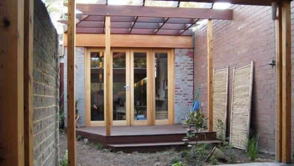 Spotted gum decking and pergola behind spotted gum carport