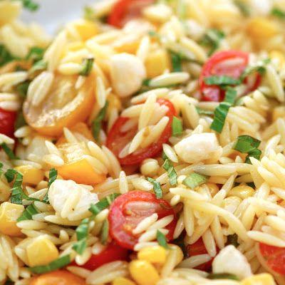 Caity's Summer Orzo Salad - orzo,tomatoes,corn,basil,fresh mozzarella, pine nuts (or try sunflower seeds), vinaigrette: 1/4 c white vinegar, 3/4 cup canola, 2-3 T dijon mustard, 2-3 t kosher salt, pepper