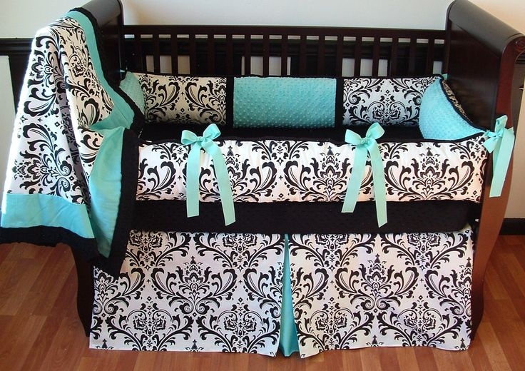 Alexandra Aqua  This set includes the bumper, blanket, and crib skirt. Black and white damask cotton print, ultra soft aqua and black minky, black piping and detail trim, and aqua grosgrain ties make this set perfect for either sex