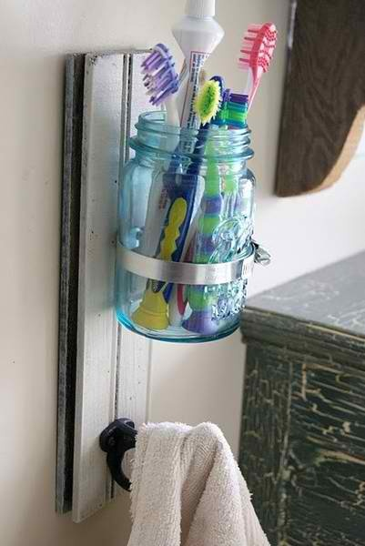 Cute toothbrush holder. Have a couple jars so you wash one in the dishwasher