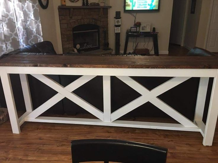 Bar table behind the couch