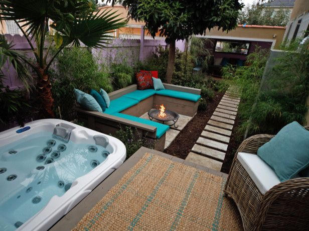 A Hot Tub Deck Fire Pit And Lush Patio Home Pinterest