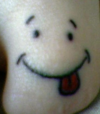 smiley face tattoos | Funny Missing Toenail Smiley Face Tattoo