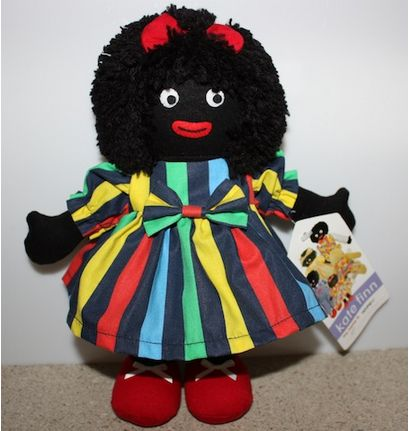 """Meet Kate Finn Golliwog – """"Topsy"""" Dressed in red shoes, white pants and vibrant striped dress and a little red bow in her hair completes the outfit. From the collection by Kate Finn. Stands approx. 26cms tall. Be her new BFF."""