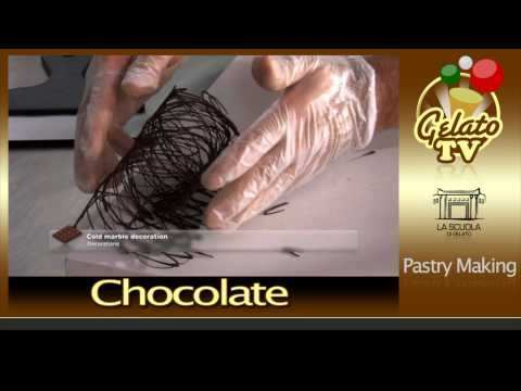 Chocolate Decorations ...  just ignore the music, lol.  okay darleen, i need a marble tile, please.  ; )  i wanna draw with chocolate.  i like the last ones as well...