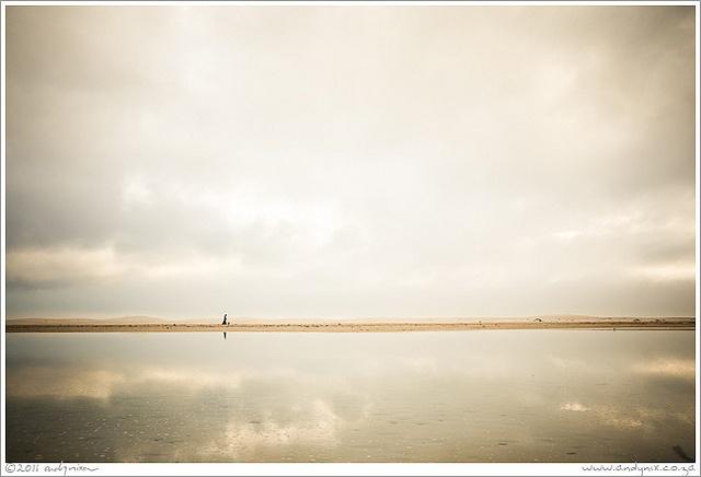 Woman walking dog, Noordhoek Beach by Girasolista, via Flickr