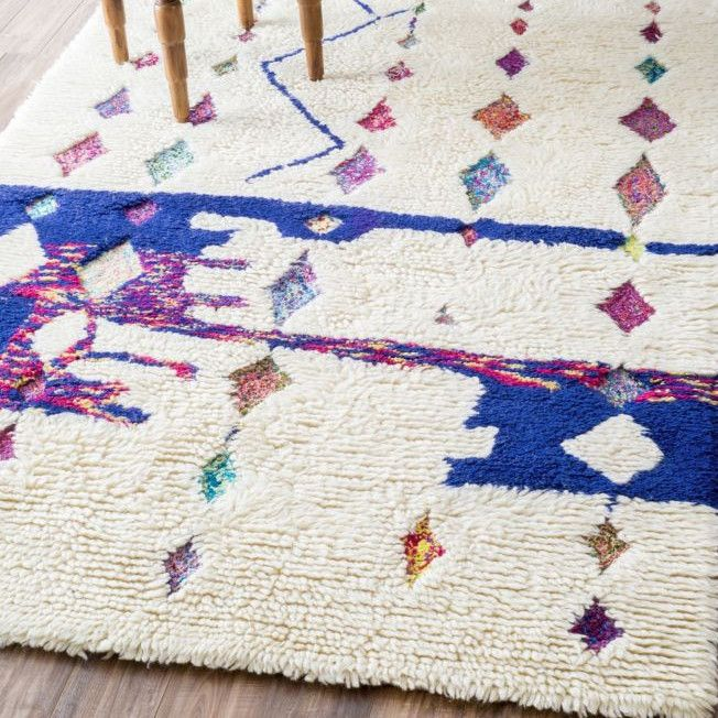 As seen on Glitter Guide. Inspired by traditional Moroccan patterns, our Naima Moroccan Shag Rug blends vintage style with soft, plush comfort. Add beautiful, unique flare to your home with this super