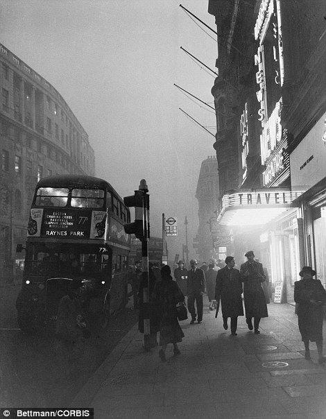 18 Nov 1953, London, England, UK ---The Great Smog of London of 1952: Pedestrians walk slowly through the haze