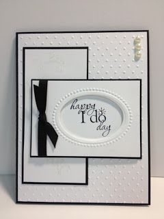 handmade wedding card ... elegant look in white with thin black matting and knotted black ribbon ... great design .... like the oval opening embossed frame for the sentiment which fits perfectly ... Stampin' Up!