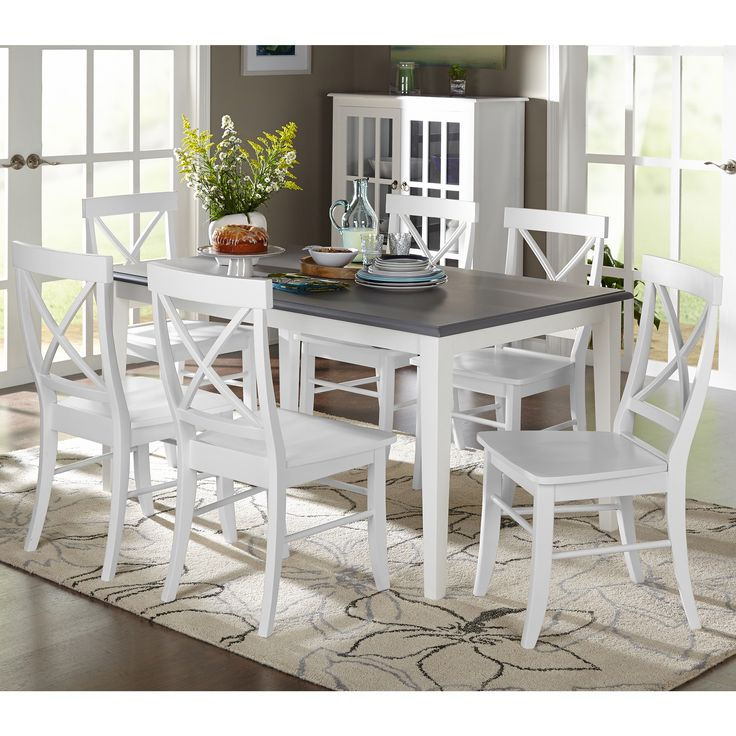 The Simple Living seven-piece Helena Dining Set features a contemporary style complemented with white and grey two-toned cool finish that is sure to add flair to any decor.