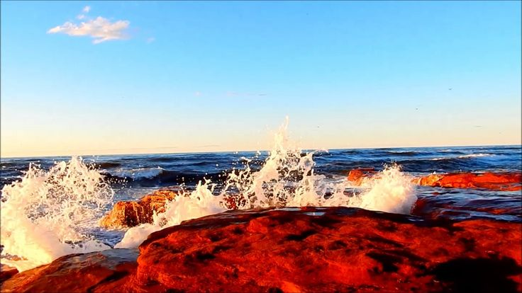 Red Sandstone coast of Cavendish Prince Edward Island and the pounding surf