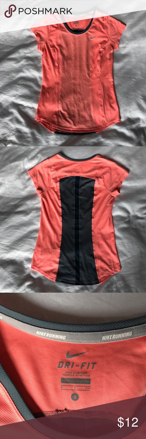 Nike Running DRI-FIT Shirt Very flattering Nike running t-shirt. Color is peach/pink and gray. Panel design for custom fit and mobility. Back wicking mesh panel in gray. Very small snags on front. Size Small. Nike Tops Tees - Short Sleeve
