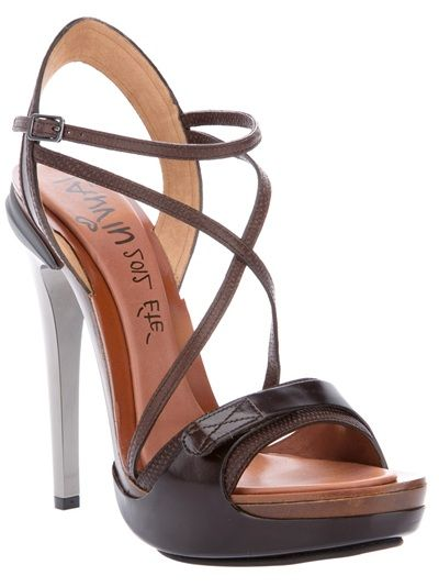 Brown lamb skin sandals from Lanvin featuring a thick front brown strap, several thin straps, an ankle strap with a buckle fastening, a small front platform and a grey heel.