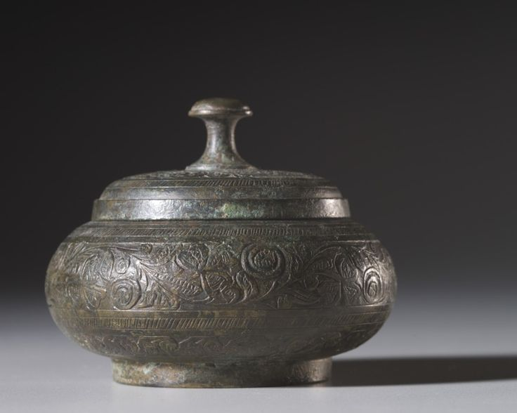 Reliquary Box, 200-400  Pakistan, Gandhara, probably Swat, late Kushan period (AD 1-320) | bronze, Diameter: w. 8.6 cm (3 3/8 in) | Overall: h. 7 cm (2 3/4 in). | Edward L. Whittemore Fund 1976.71 | Cleveland Museum of Art