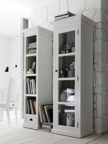 Detailed wooden molding tops a columnar bookshelf with fixed shelving. Display not just books, but collectibles as well. Perfect for small spaces.