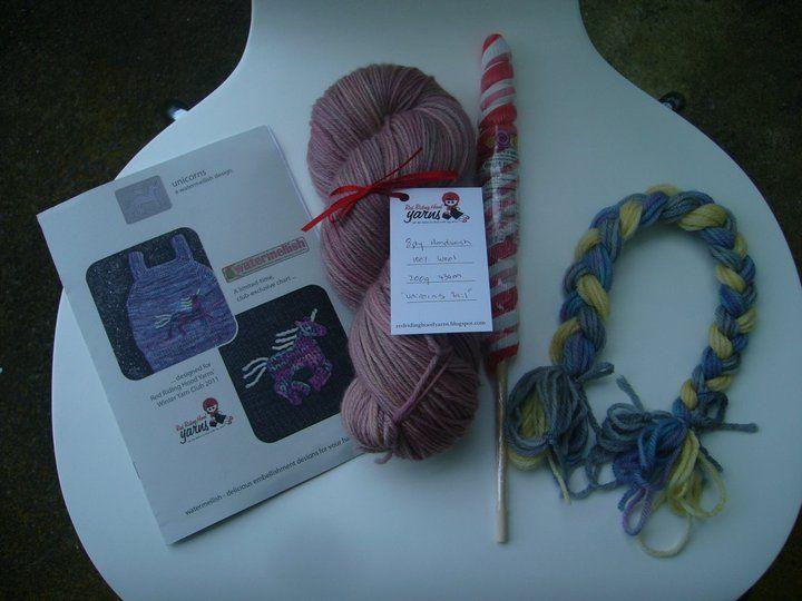 "Winter Yarn Club 2011 - August (Unicorns and Dragons) Girls package includes: ""Watermelish"" Embellishment chart, Unicorn Tail yarn, Unicron horn lollypop, plait of co-ordinating embellishing yarns."