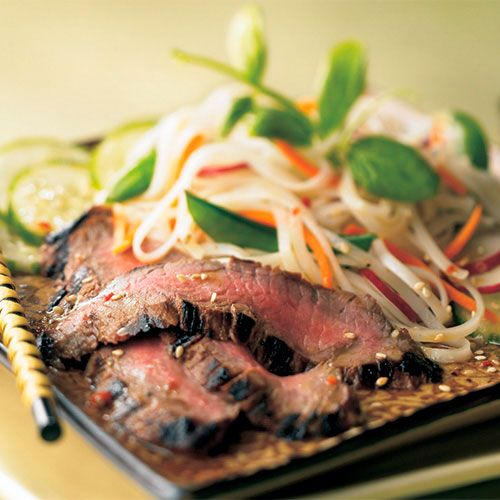 This exotic salad, featuring a nice textural contrast between rice noodles and crisp vegetables, uses part of the wasabi salad dressing as a marinade for the steak.