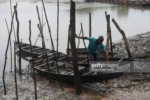 06-26 A fisherman comes out of a boat on Bodo River devastated... #bodo: 06-26 A fisherman comes out of a boat on Bodo River… #bodo