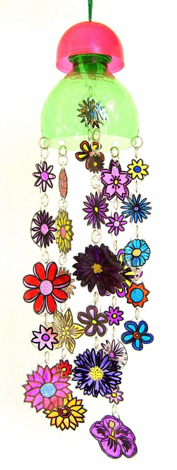 "This flower suncatcher mobile is made of recycled plastic from take out containers, and plastic bottle parts. The pink dome is from a gumball machine toy container. There are five strands of flowers, and two additional flowers hanging beneath the dome. It measures approximately 14"" in length. There are 18"" of shiny green twine at the top for hanging."