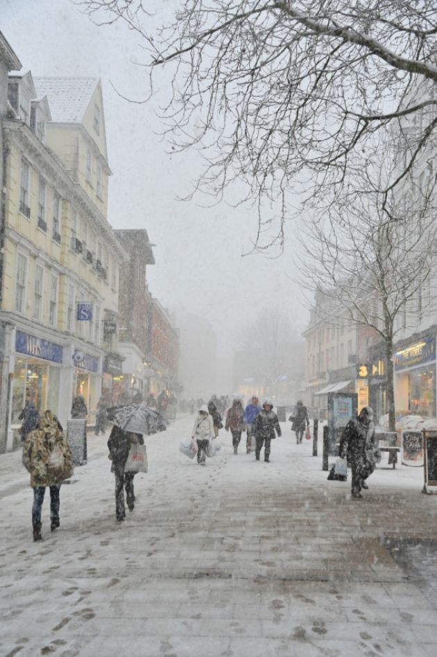 The sudden deluge of snow turns Norwich city centre white and walking