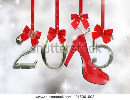 High heel shoe and 2015 number hanging on red ribbons in a glittery background