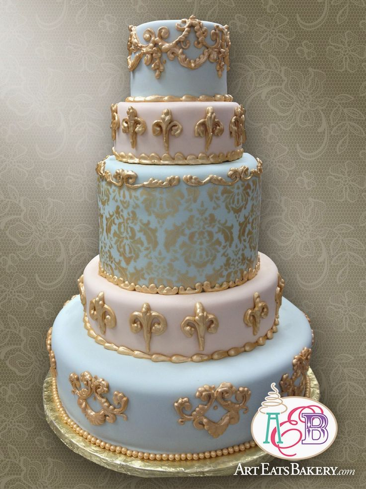 Art Eats Bakery 1626 East North Street, Greenville, SC 29607https://www.facebook.com/ArtEatsBakerySC5 Tier Elegant Baroque blue and pink ornate elegant fondant Wedding Cake with Gold Damask Pattern and hand piped royal icing flourishes designThe best custom designed unique #creative #modern birthday, baby shower and elegant romantic wedding cakes create a personal element to your party or reception that cannot be matched by decor or venue. It is the first thi...