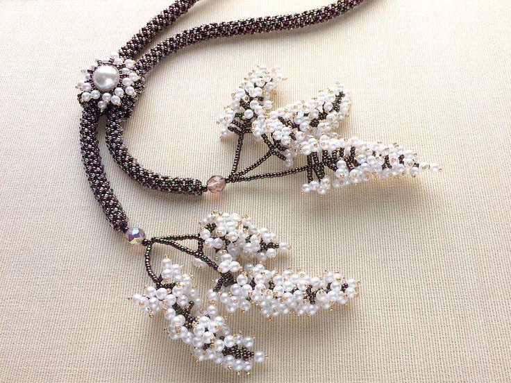 Jingling andromeda bead necklace