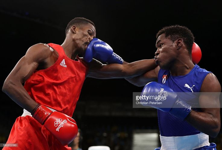 Lorenzo Sotomayor Collazo (L) of Azerbaijan fights against Yasnier Toledo of Cuba during the Men's Light Welter (64kg) Quarterfinal 4 on Day 11 of the Rio 2016 Olympic Games at Riocentro - Pavilion 6 on August 16, 2016 in Rio de Janeiro, Brazil.