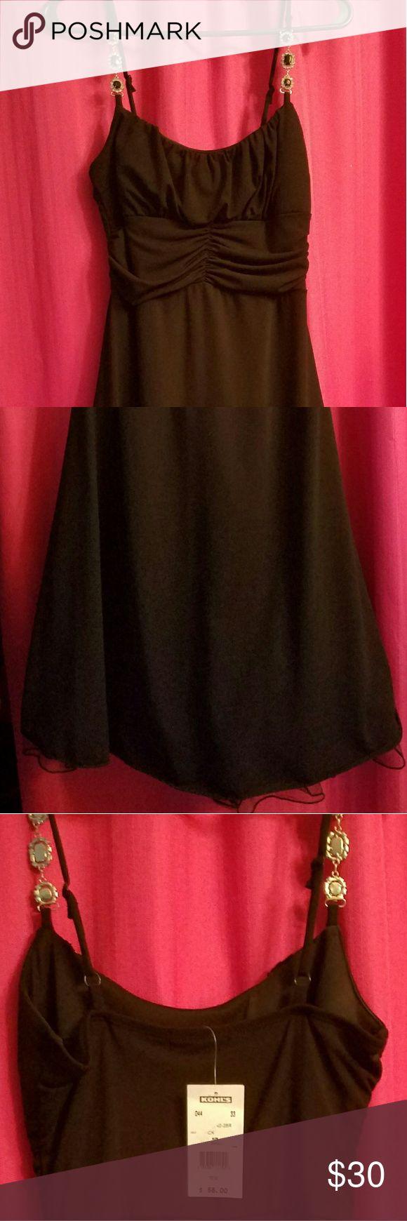 Black spaghetti strap Dress Black spaghetti strap Dress. Size small. Adjustable straps. Bought from Kohl's. Never worn. Dresses Midi