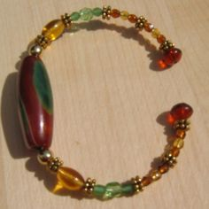 I had gone to a gem shop and found these wonderful stone beads that I thought would make great focal beads for a bracelet. I used memory wire.I mixed different fire polished beads and crystals and a few spacers. I loved the color combinations. The end beads are glued on as I do not like the bent ...