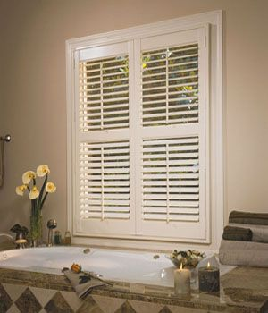 This is a wood and PVC mix plantation shutter that looks and feels like real wood.