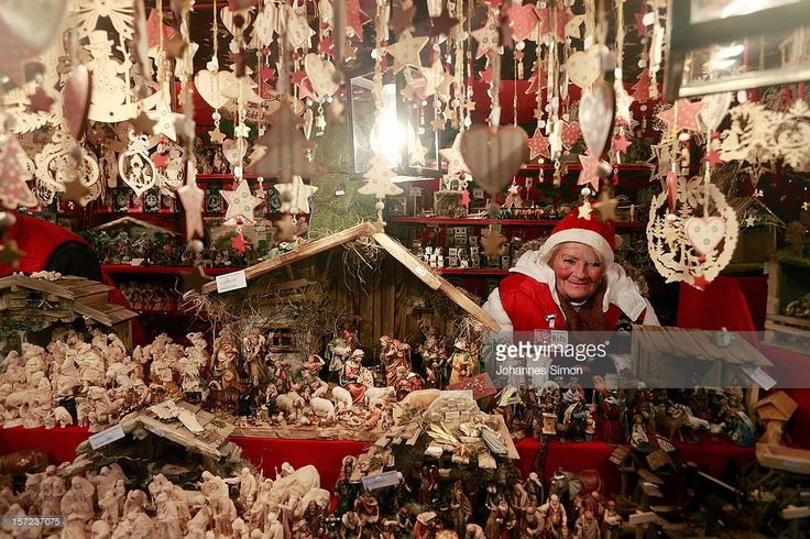 christmas-decorations-hang-for-sale-at-a-stand-at-the-traditional-picture-id157237075 (1024×683)