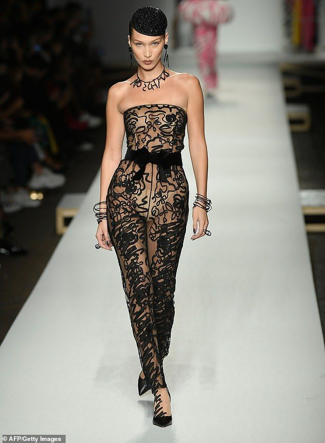 f1dac1e40667 Bella Hadid goes braless under sheer jumpsuit at Moschino show for MFW
