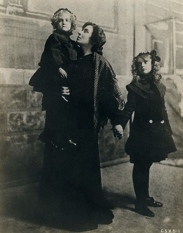 Lillian Gish, right, stands with her mother, Mary Gish, who holds Dorothy Gish.