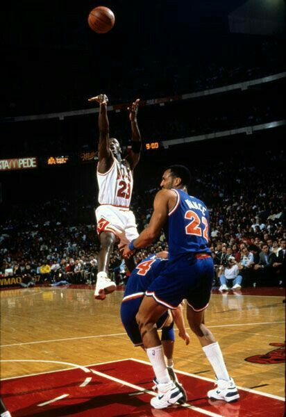 The GOAT gets off a quick jumper before the Cavs' Ron Harper and Larry Nance Sr can react during a game in Chicago.