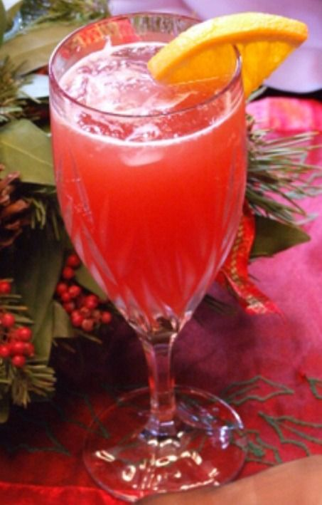Open up your gifts on Christmas morning with these cranberry mimosas in hand.
