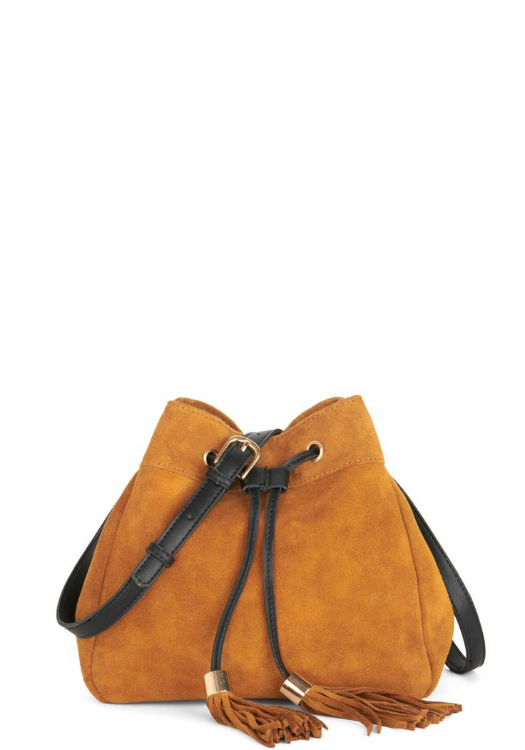 Wild, Wild West Coast Bag. As you lay eyes on the Pacific for the first time, you reach a hand into this suede shoulder bag and pull your camera out to capture the sun setting over the water. #tan #modcloth http://pbly.co/EA_a130