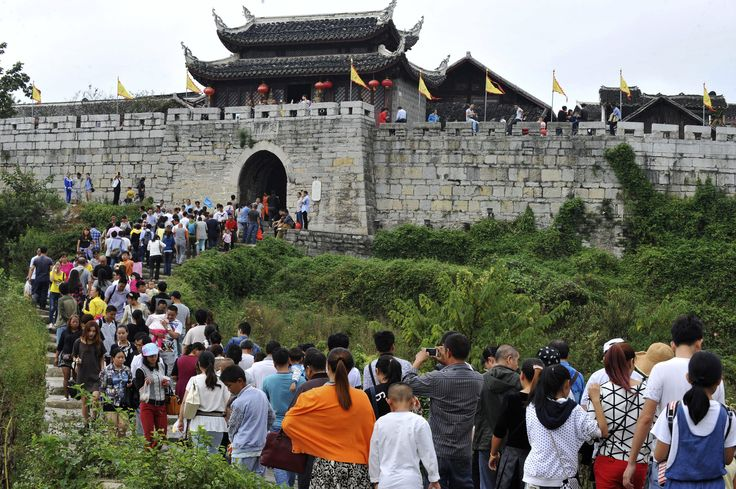 Tourists visit the Qingyan Ancient Town on the third day of the seven-day national day holiday, in Guiyang, Guizhou province October 3, 2014. The national day holiday, known by many Chinese as 'the Golden Week' for travel, started on October 1 this year, celebrating the 65th anniversary of the founding of the People's Republic of China. According to a prediction by the China Tourism Academy, a total of 480 million trips are expected to be made by travellers within these seven days, Xinhua…
