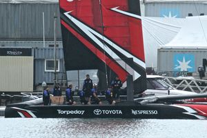 Emirates Team New Zealand's new AC50 is launched for the first time at the Team's base in Auckland. The crew are sitting on the new cycle grinder pedestals. Photo / Photosport