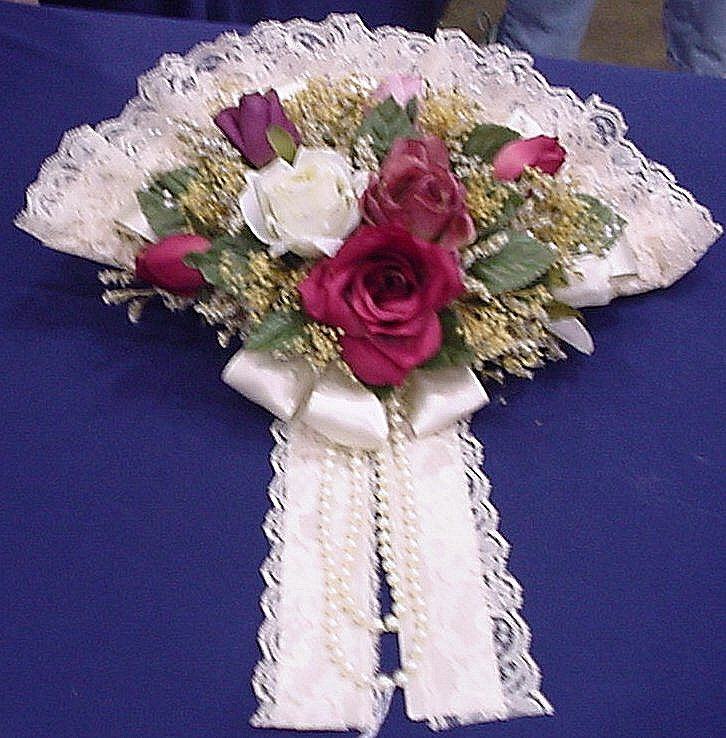 Image detail for -... lace fan with rolls of lace and a bouquet of roses added in is a