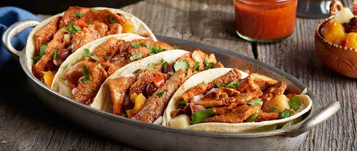 Elevate your senses and your menu with this Tacos al Pastor with Red Beans and Oaxaca Cheese Cornbread <br /><i>Recipe by Chef Jose Garces</i> recipe from Smithfield.