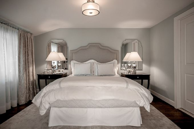 A glamorous master suite. The drapery consists of two ...