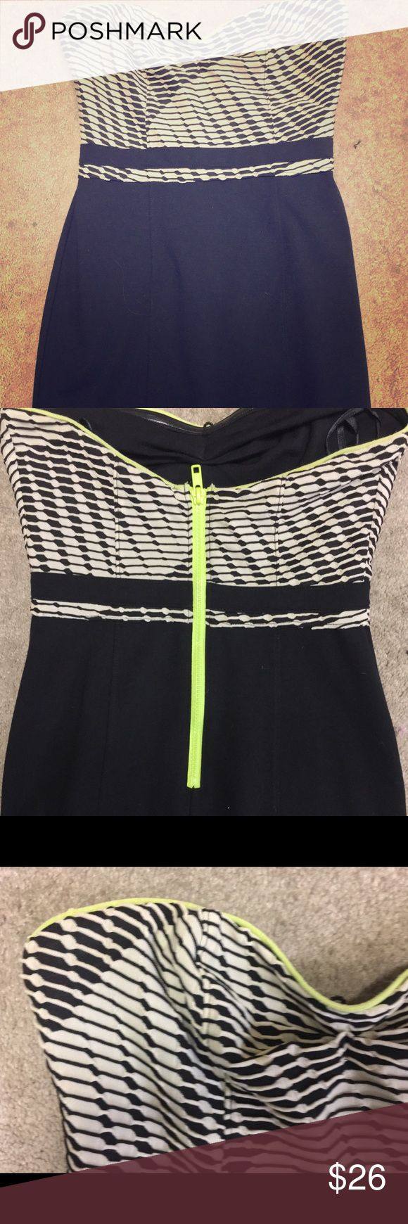 Silence + Noise Strapless Bodycon Dress Silence + Noise black and white with neon yellow piping detail Strapless bodycon dress. Dress has black and white sweetheart neckline with neon yellow piping and exposed neon yellow back zipper. Bottom is solid black and fitted. Worn once! Size Small. silence + noise Dresses Mini