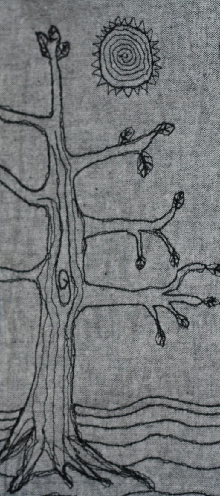 The lonely tree in freehand machine embroidery.