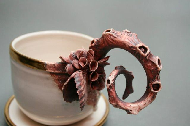 """As if lifted from the wreckage of the Titanic, ceramic artist Mary O'Malley creates sculptural porcelain teapots, cups, and vases adorned with barnacles, tentacles, and other living sea creatures (she refers to them as """"porcelain crustaceans""""). Many original works from"""