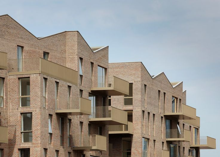 http://www.dezeen.com/2015/03/13/duggan-morris-brentford-lock-west-london-canalside-housing-brickwork-golden-metal/