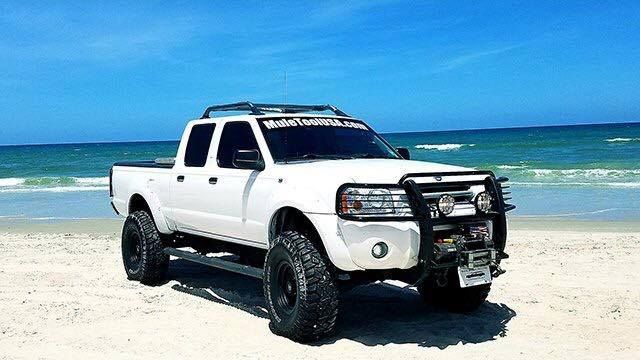 """Here's our first entry for #JCWFiveStarFridays, we have here Eric's 2004 Nissan Frontier and he said,  """"its a 2004 nissan frontier xe 4x4. It has a 3 inch calmini suspension lift 3"""" performance body lift, custom brush guard and tail light guard and 35 inch tires on 15"""" offset rims. It also has a custom mounted 12,000 pound winch  I use it as my daily driver plus have pulled over 100 vehicles stuck in the sand with our Free Hand in the Sand program. We accept only donations which all funds…"""