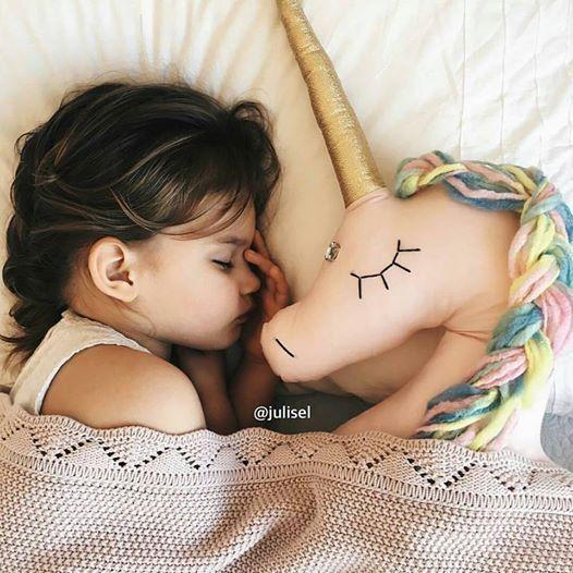 unicorn pillow nursery interior
