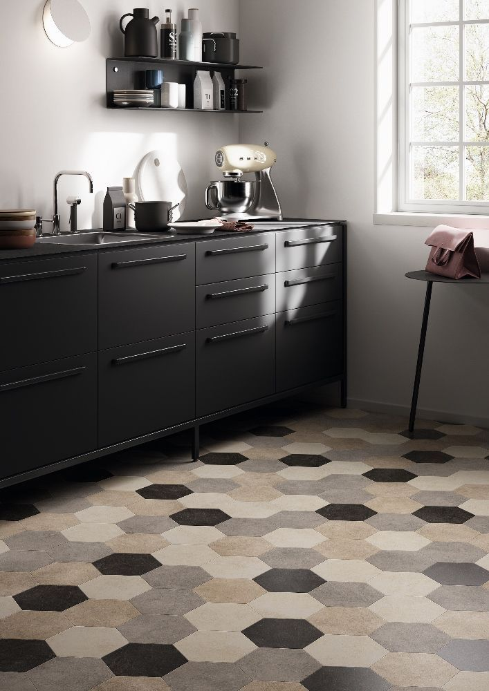 Pin 5: Vinyl flooring laid out in a kitchen. Vinyl flooring is laid on the floor like a rug and can be heavy.